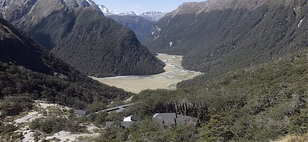 There's a great view up behind the two huts, guided closest, DOC behind. | Routeburn Falls Hut, Routeburn Track