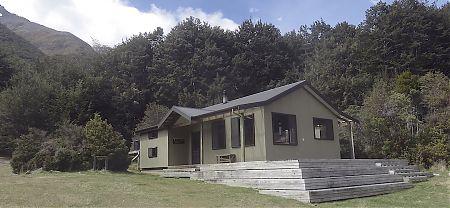 The hut is a fairly compact structure.    Greenstone Hut, Greenstone Track