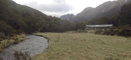The hut is close to the upper Greenstone River not far from the lake. | McKellar Hut, Greenstone Track