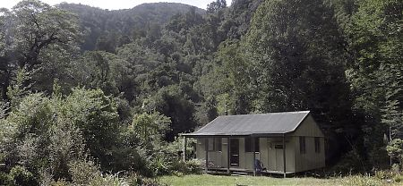 Quite the attractive setting for a hut.  | Demon Trail Hut, Hollyford Track