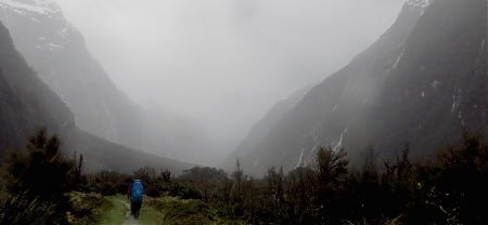 It's rather wet and you can't make out all those waterfalls, but there are walls of them. | Milford Track, Fiordland National Park