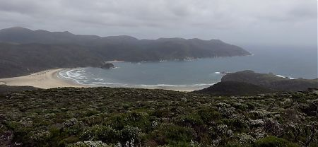 Doughboy Bay  in the gloom from Doughboy Hill. | Southern Circuit, Stewart Island