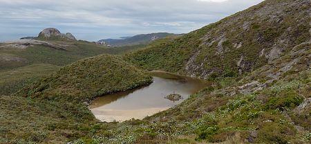 The lake under Mt Allen with Lees Knob beyond. | Tin Range route, Stewart Island