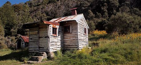 The exterior walls are constructed from nearby fallen trees.  |  Chaffey Hut, Kahurangi National Park