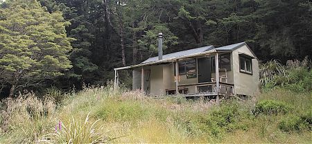 You can see the later addition to the hut. It's a great verandah. |  Helicopter Flat Hut, Kahurangi National Park