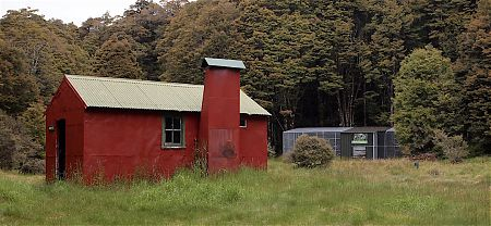 The Wainui Hut has a nearby aviary to acclimatise bird releases.   Wainui Hut, Abel Tasman National Park
