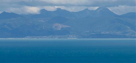 The view over to Nelson with the top of Mount Richmond in cloud. |  Abel Tasman National Park