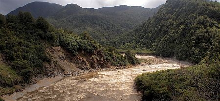 The Mokihinui River was way up, churning and looking way ugly. | Old Ghost Road