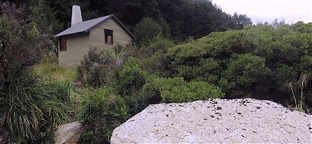 The hut is close to the river.   Hurricane Hut, Matiri River, Kahurangi National Park
