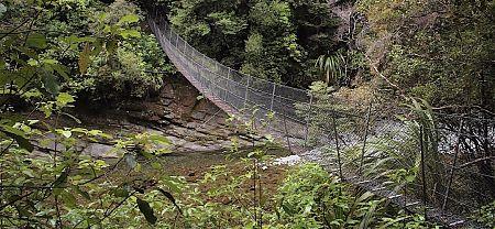 There's a swingbridge to cross the Wangapeka River.   Wangapeka Track, Kahurangi National Park