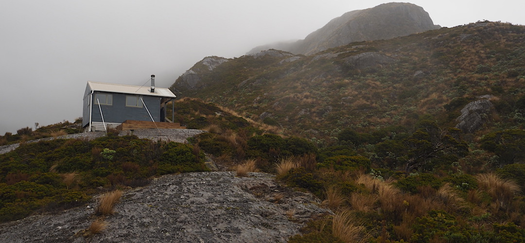 The hut is well secured to the rock. It needs to be due to the exposed location.   Bluff Hut, Hokitika River, West Coast