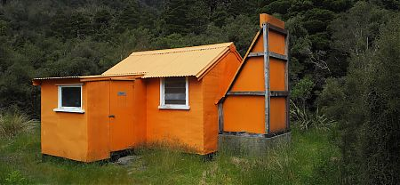 The old 1958 hut stands out . | Cedar Flats Historic Hut, Toaroha River, West Coast