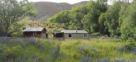 The old and new huts. | Lake McRae Hut, Lake McRae
