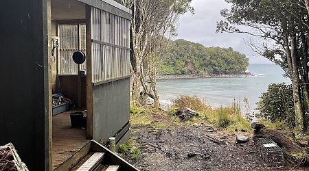 Looking somewhat run down on the outside.    Christmas Village Hunters Hut, Stewart Island/Rakiura