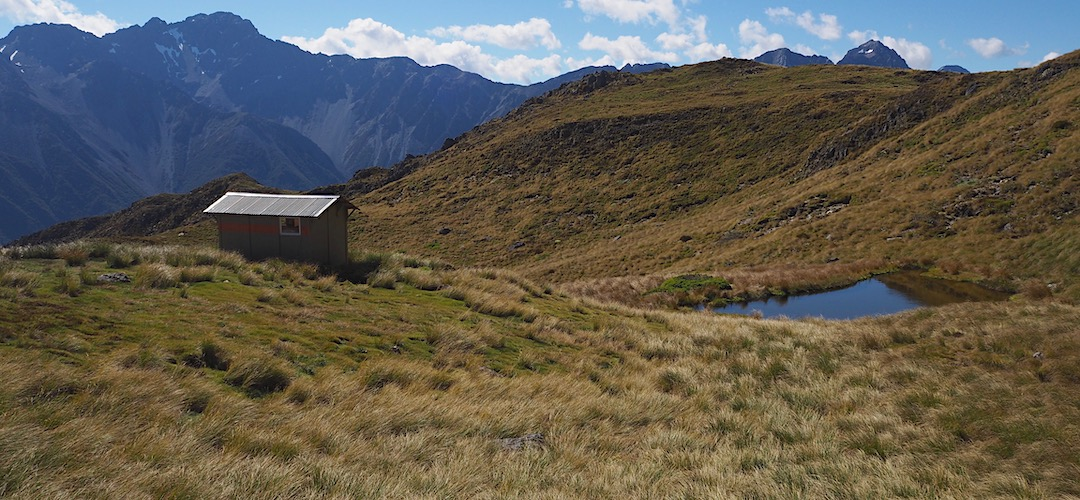 Once you get up there its flat, with the tarn close by.   Mt Misery Hut, Nelson Lakes National Park
