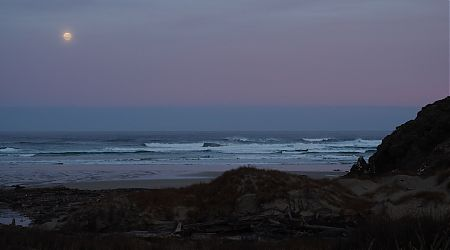 Full moon setting into the Tasman Sea at Little Hellfire Beach. | Northwest Circuit, Rakiura National Park