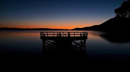 Sunrise over the Freds Camp jetty on Patterson Inlet. | Southern Circuit, Rakiura National Park