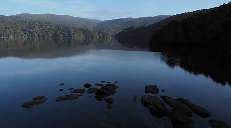 Early morning reflections on Patterson Inlet from near North Arm Hut. | Northwest Circuit, Rakiura National Park